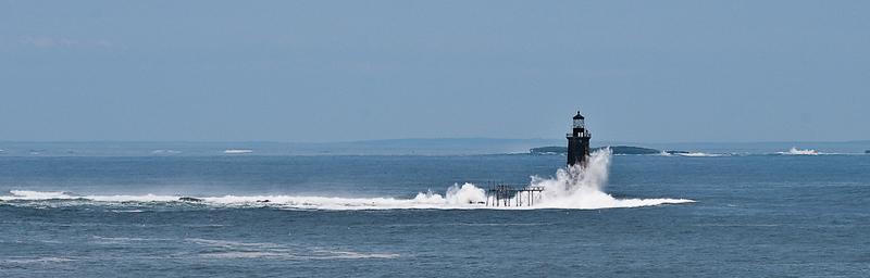 Waves from hurricane Bill, 2009, batter Ram Ledge lighthouse in Casco Bay, Maine.