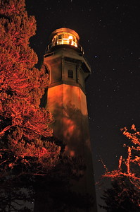 The lighthouse at night lit by the light of our campfire.