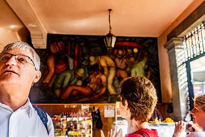 Tourists admiring the murals in Abelardo Rodriguez Market in Mexico City