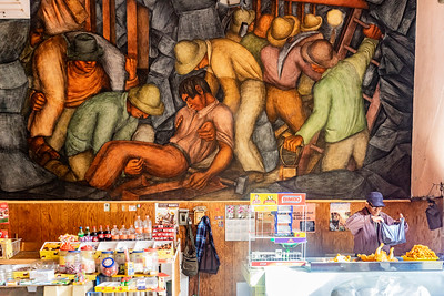 Mural in the style of Diego Rivera above a stall in the Abelardo Rodriguez Market in Mexico City