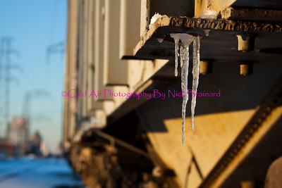 SMPLS_Railcar.jpg  A small icicle hanging from the corner of a graffiti painted rail car in south Minneapolis. Lighting against the side of the rail car is from the sun going down on a cold December day.