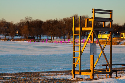 SMPLS_Hiawatha_Lifeguard.jpg  This photo was taken in early December at a small local beach on Lake Hiawatha. This lifeguard platform was being spectacularly lit up by the beautiful sun set in the background wail the frigid lake is frozen. This photo represents the changing of hobby's that accompany the changing of seasons. The sun is going down on the beach and coming up on a ski resort.