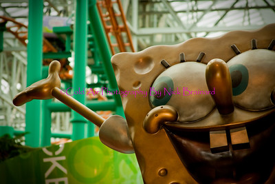 "MOA_Sponebob.jpg  This statue is located at the main entrance of Nickelodeon Universe. At the base of the golden statue is  the parks slogan ""Think Happy""."