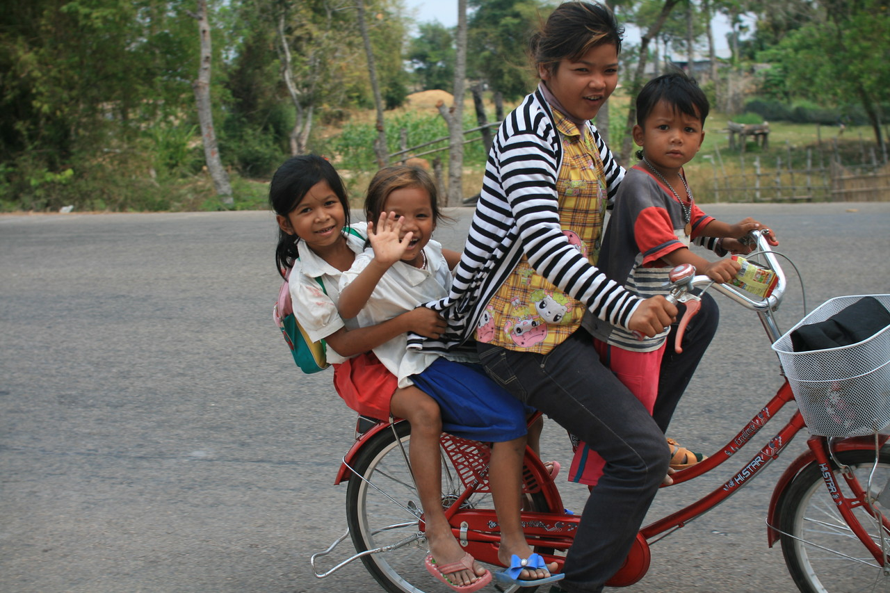 Getting overtaken by a bike carrying four people