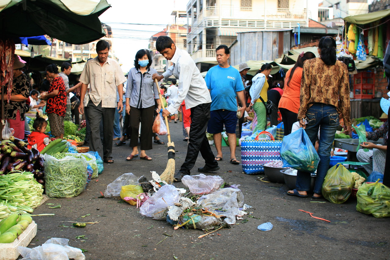 Market areas in Cambodia are filthy: trash covers the ground. This was the first one I saw being cleaned.