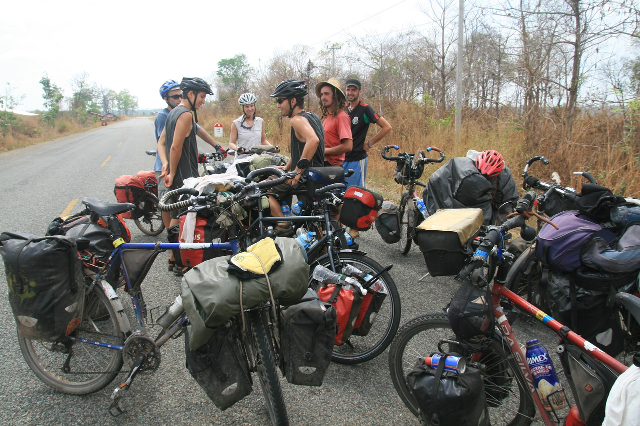 Totally unplanned gathering of a LOT of bike tourers on an empty stretch of road near the border between Cambodia and Laos.