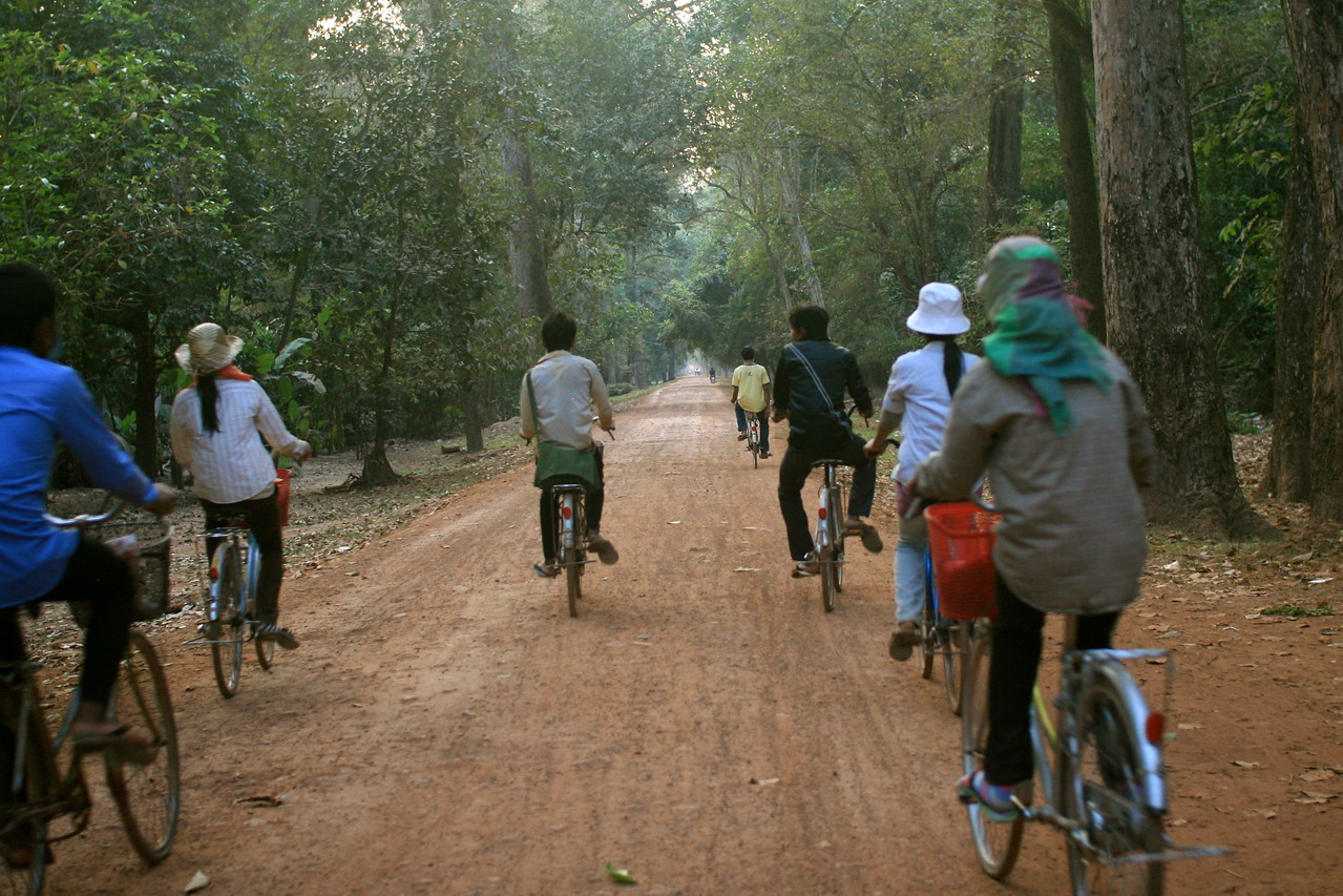 Being overtaken by a crowd on bikes - probably workers at the Angkor Wat temple complex - on their way home at the end of the day