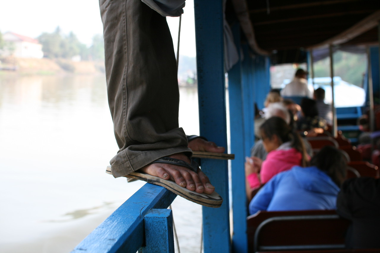 A man stands up for a better view or fresh air on the boat between Battambang and Siem Reap, Cambodia.