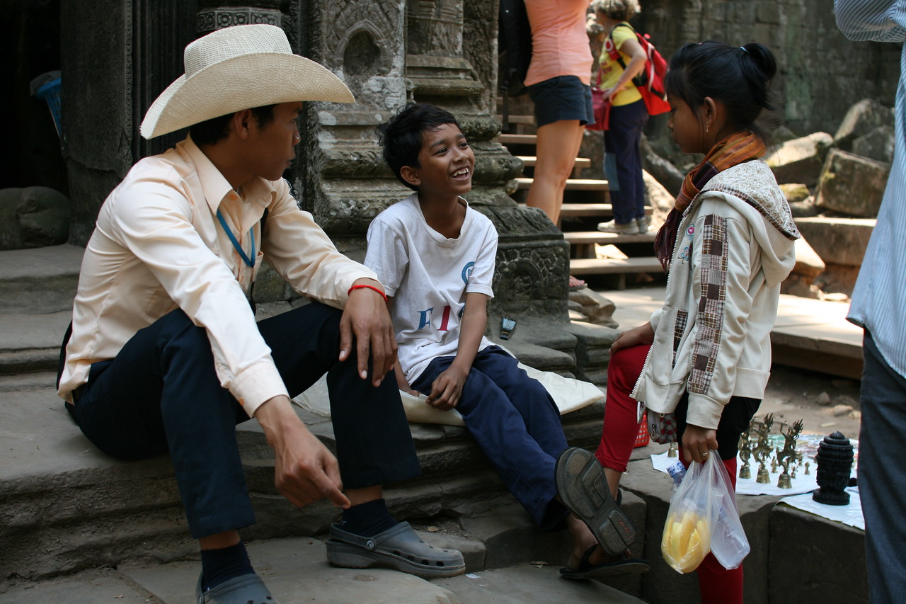 Locals at the Angkor Wat temple complex having a laugh, Cambodia.