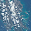 Caption by Space Station Academy student: This picture has the clouds, land, and waters of Dominica. The Carribean Sea is bordering the island. This picture is very pretty. The nice blue waters and the beautiful island looks like a perfect vacation destination.