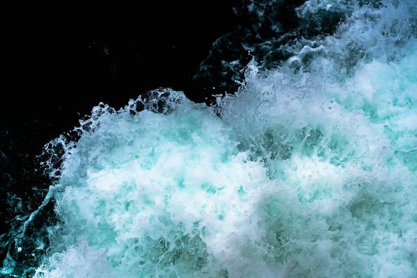 The water behind a catamaran