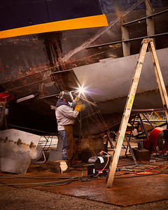 Welder Working On A Boats Hull - Port Townsend, Washington