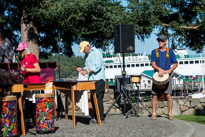 Bruce playing drum with the Kubatana Marimba band