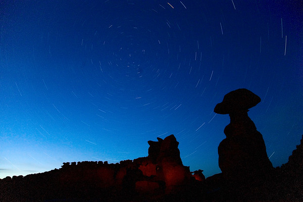 <i>Hoodoos and star trails. Goblin Valley State Park, UT</i>   After dinner we raced back to Goblin Valley to catch the sunset. We then had our first night shoot. We did long exposures and painting with light against the hoodoos.  We got back to Hanksville around 11pm.