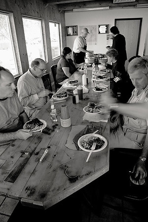 <i>Chowin' down. Hanksville, UT</i>   After the review we were treated to a dutch oven dinner.