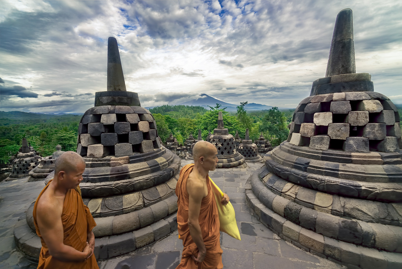 Buddhist Monks circle the stupa at Borobudur Temple in Yogyakarta Indonesia