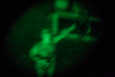 Life through NVGs (night vision goggles). U.S. Army recruit training. Fort Leonard Wood, Missouri.