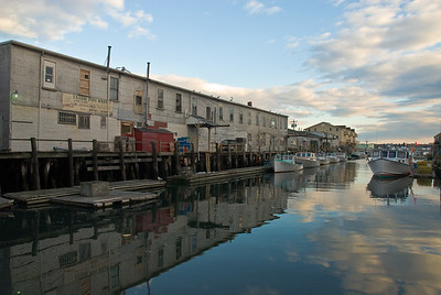 Reflections of buildings on Custom House Wharf in Portland Harbor - Portland, Maine