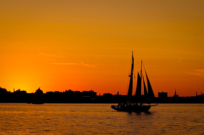 An August afternoon sail in Portland Harbor on the Wendameen. The sun is setting over the Portland skyline.