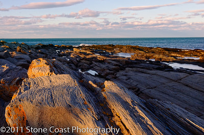 Sunset colored rocks at Two Lights in Cape Elizabeth, Maine.