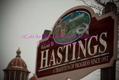 Hastings_CitySign. jpg  This is the Hastings welcome sign when coming in to the town from the north with the city hall building in the background.