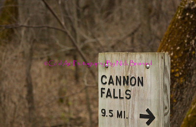 """Welch_Bike_Path.jpg  This is a """"road sign"""" at the Welch Station on the Cannon Valley bike trail indicating that Cannon Falls is 9.5 miles away. The path connects Red Wing and Cannon Falls and is 19.4 miles in its entirety."""