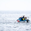 #fishing off #Pirnmil on #arran #isleofarranWe were struggling to find much of interest on this shoot last week, but as ever, patience paid off as these folks motored by to provide some focus.  The light was fairly flat and diffuse, but the contrasting colours of the boat and its crew allowed that to be punctuated and composed in a way that I quite like.