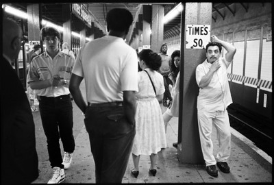 Woman waiting for the train, Times Square, New York City circa 1988.