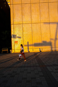 Woman walking outside of Taipei City Hall, Taipei 2019.
