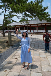 Woman taking a selfie, Nara Temple, 2019.