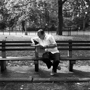 Man reading newspaper, Central Park, 1988.