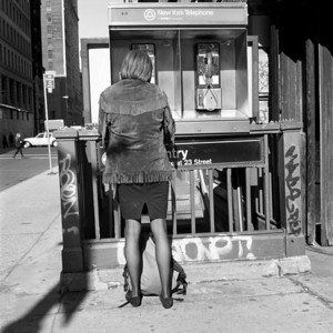 Woman using payphone near 23rd St., New York City, 1987.