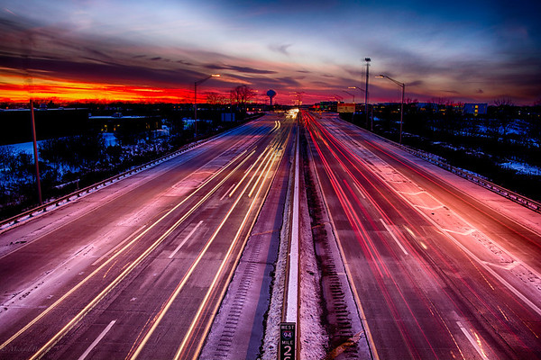 Sunset 11-22-13 as the sun set over the tollway north of Chicago, IL. I enjoy shooting in HDR because it captures the range of a sunset much better than a single image. There was a little time lapse on some of the cars.