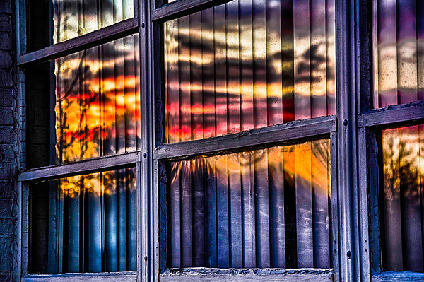 Sunset 11-23-13 as the sunset north of Chicago, Illinois. This is the a set of windows on a building facing west. I really like how the light was captured and the colors of the sunset.