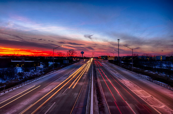 Sunset 12-12-13 as the sun set over the tollway north of Chicago, IL. I enjoy shooting in HDR because it captures the range of a sunset much better than a single image. There was a little time lapse on some of the cars.