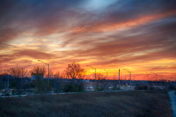 Sunset 11-4-13 as the sun set over the tollway north of Chicago, IL. I enjoy shooting in HDR because it captures the range of a sunset much better than a single image. There was a little time lapse on some of the cars.