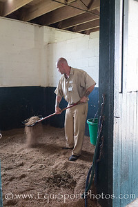 Anthony, an inmate at the Blackburn Correctional Facility cleans stalls in the barn for the TRF horses kept at the Blackburn facility.