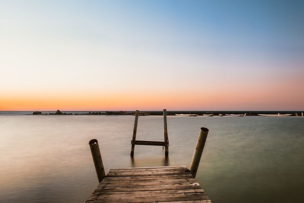 A Pier in the Sunrise Glow