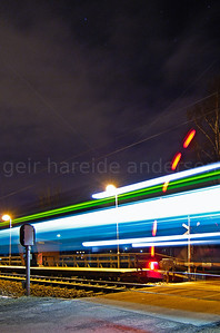 Night image of train crossing with passing train
