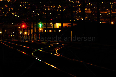 Night image of railway rails and signal lights