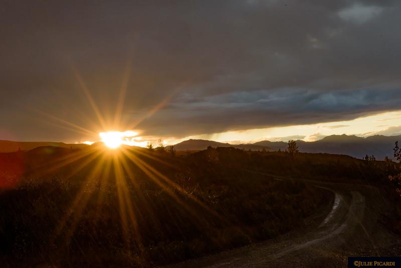 The sun rises illuminating Denali Park Road.