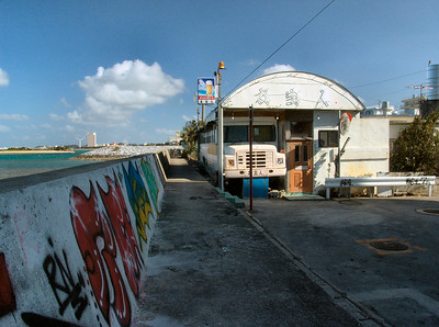 Someone has converted an old schoolbus into a seaside bar.