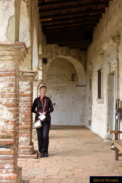Debs in the ancient open breezeways of the mission.