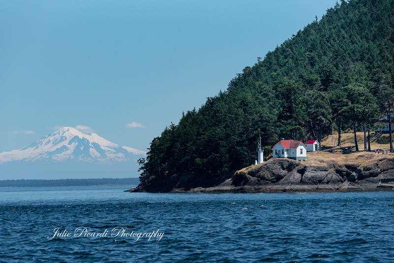 The only thing missing here is the Orca swimming in front of the light house .