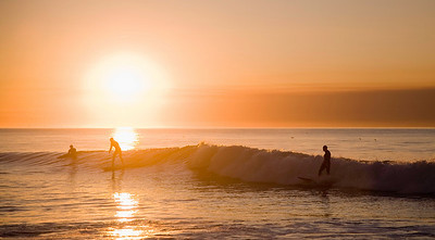 Surfers at dawn.