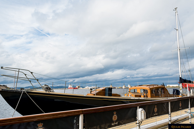The 1936 racing yacht Bloodhound owned by Prince Philip and the queen is berthed next to the Britannia.