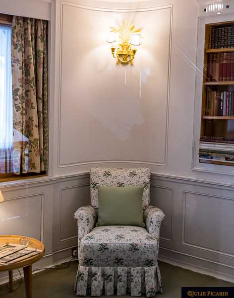 A chair in the queen's sitting area.