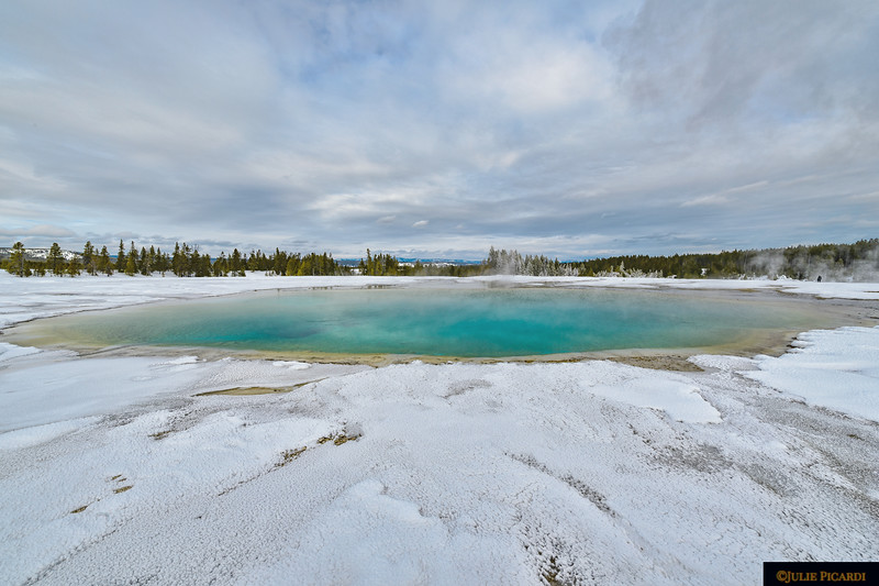 Turqoise Pool rimmed by snow.