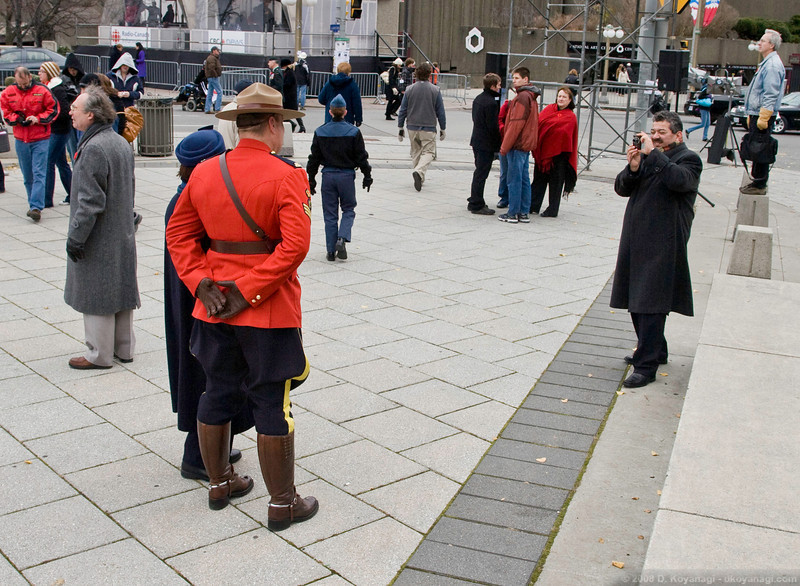 Pommie tourists posing with a mountie.