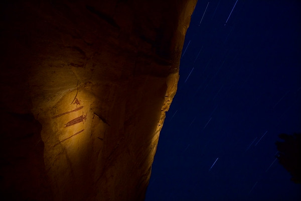 Petroglyphs and star trails. San Rafael Swell, UT